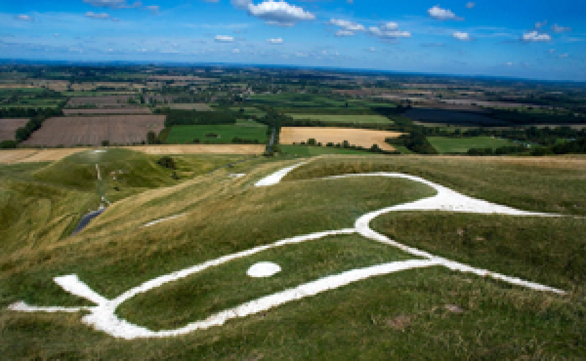 Uffington White Horse with view over vale.