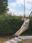 Opening of the new play equipment July 2019 - Cllr Bartle tries out the new zip wire